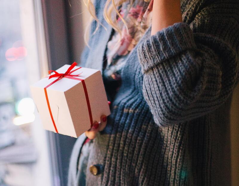 woman-wearing-blue-knit-cardigan-holding-gift-box-inside-776943 (2).jpg